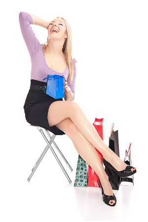 Caucasian sitting with gift bags Stock Photo - 6719779