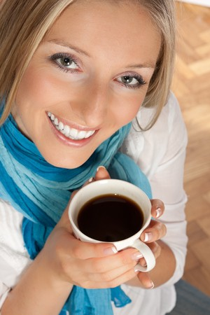 Caucasian woman with cup of coffee photo