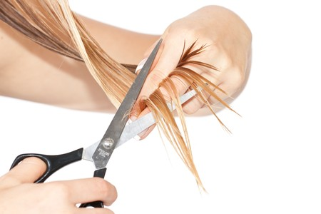 Frau schneiden Haare  Standard-Bild