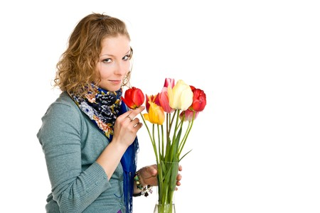 Caucasian young girl with tulips on isolated background photo