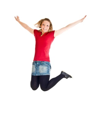 Girl jumping on white isolated background photo