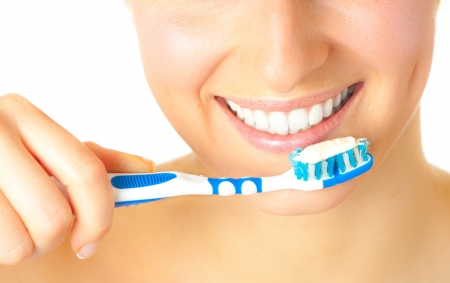 Woman healthy teeth closeup brushing concept photo