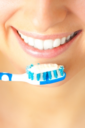 tooth decay: Woman healthy teeth closeup brushing concept
