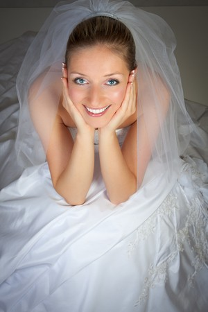Young woman in wedding dress in studio photo