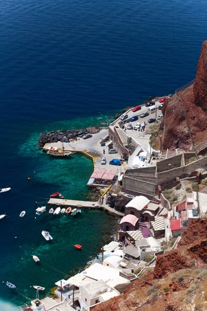 Santorini beautiful volcanic island in Greece landscape with blue churches, windmills and volcanic caldera photo