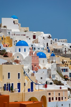 aegean sea: Santorini beautiful volcanic island in Greece landscape with blue churches, windmills and volcanic caldera
