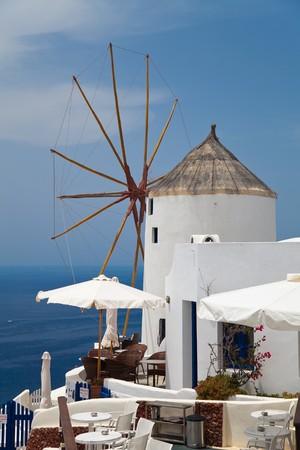 Santorini beautiful volcanic island in Greece landscape with blue churches, windmills and volcanic caldera photo