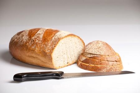 bread knife: Fresh natural wheat bread Stock Photo