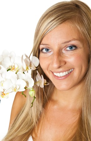 Young blond tan caucasian woman with orchid flowers isolated photo