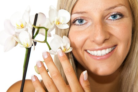 Young blond tan caucasian woman with orchid flowers isolated Stock Photo - 7408914