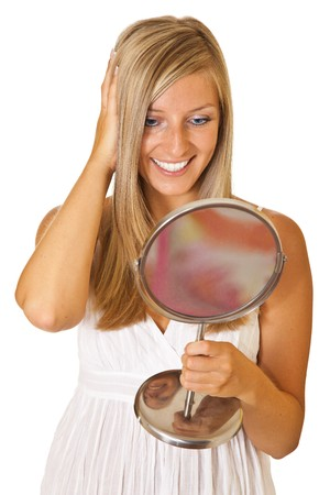 Young caucasian blond woman with mirror isolated photo