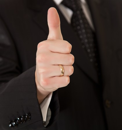 Business man in suit thumbs up on white isolated background photo