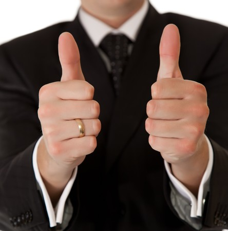 Business man in suit thumbs up on white isolated background Stock Photo - 7779531