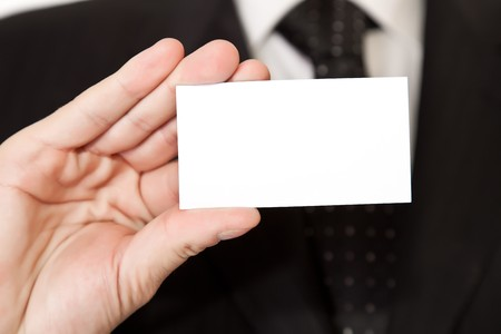 Business man holding blank card on white isolated background photo
