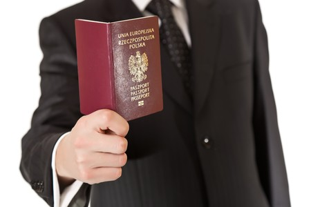 Man in suit holding passport photo