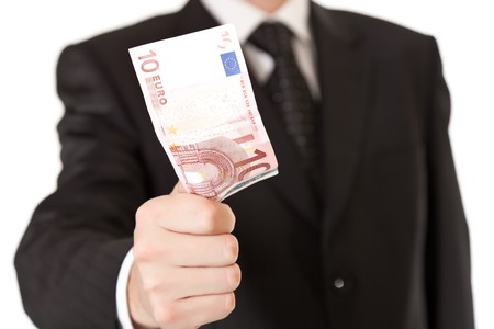 Man in suit holding money photo