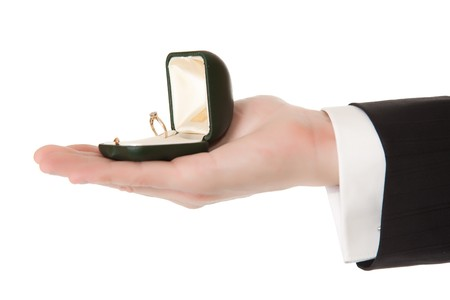 Man in suit holding engagement ring on white isolated background Stock Photo - 7779476