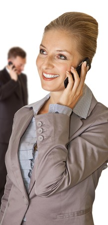 Business woman talking on the phone with man in background Stock Photo - 7779645