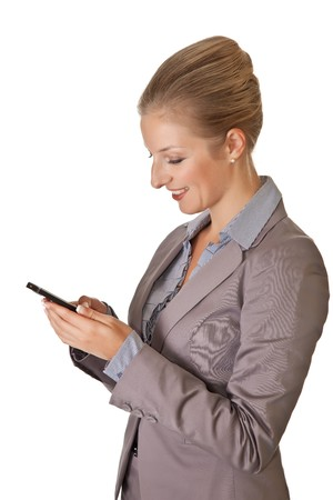 Caucasian blond businesswoman in suit with cell phone on white isolated background photo