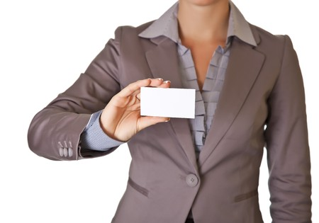 Caucasian blond woman holding blank business card wearing business suit isolated photo