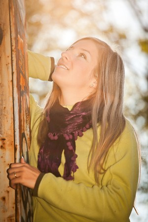 Caucasian young adult blond woman outdoor fall time photo