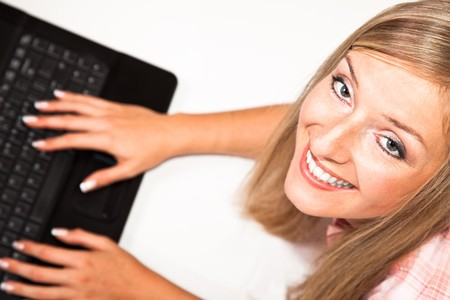 Caucasian woman with notebook on white isolated backgrodun Stock Photo - 8090610
