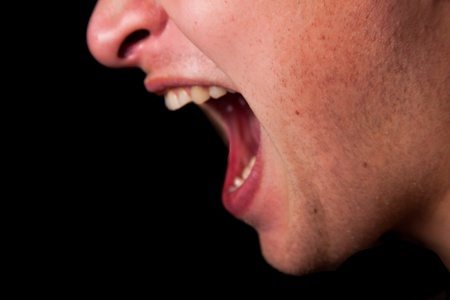 bawl: Yelling woman mouth closeup