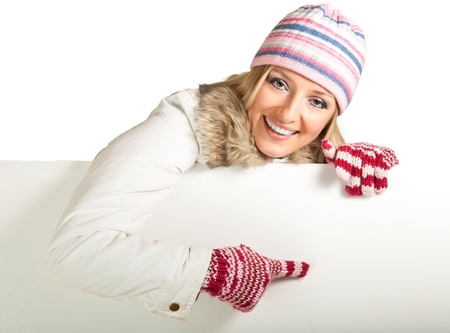 Woman in colorful hat and gloves peeping from behind whiteboard isolated on white Stock Photo - 8353195
