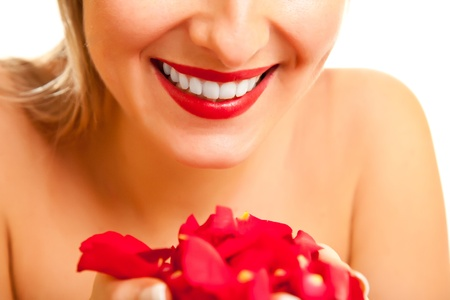 Beautiful caucasian woman with red roses on white isolated background photo