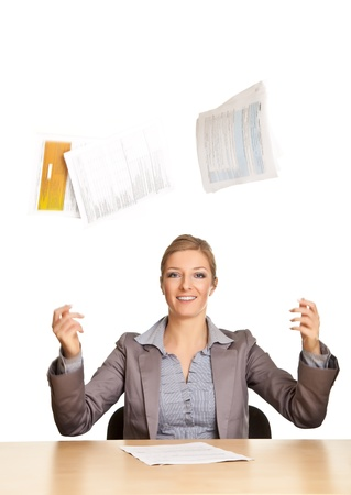 Busiesswoman throwing documents isolated on white photo