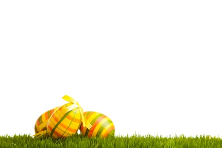 Easter eggs and chickens on green grass on white isolated background Stock Photo - 8819090