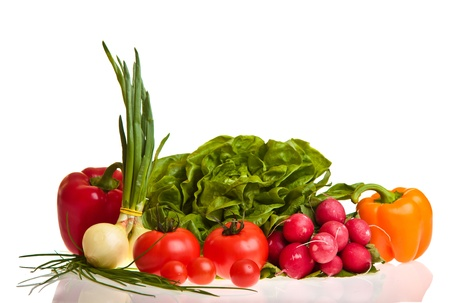 Different ripe vegetables compositions in studio isolated on white photo