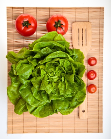 Different ripe vegetables compositions in studio laying on bamboo plate Stock Photo - 8979824