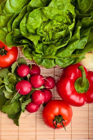 Different ripe vegetables compositions in studio laying on bamboo plate Stock Photo - 8979836