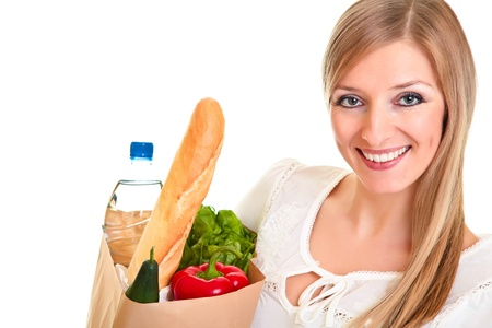 Woman carrying bag of groceries isolated on white photo