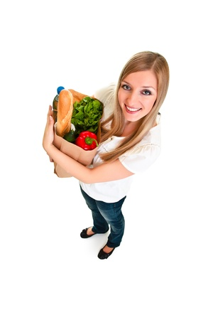 Woman carrying bag of groceries isolated on white Stock Photo - 8968310