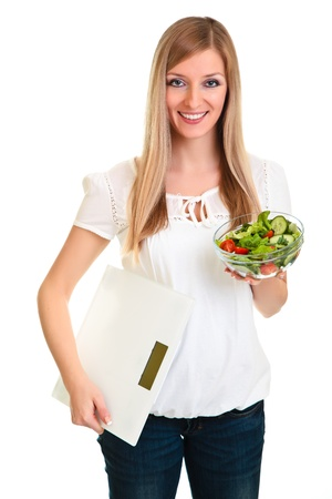 Woman with salad and scales isolated on white photo