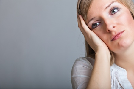 Depressed, sad woman on neutral background Stock Photo - 9122503