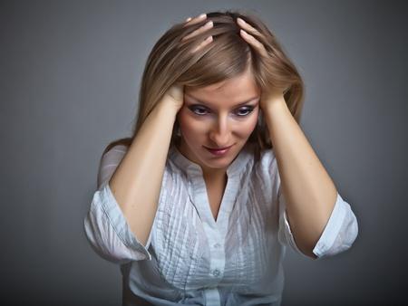 Depressed, sad woman on neutral background Stock Photo - 9122450