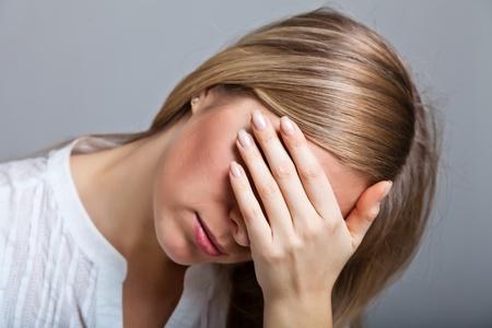 Depressed, sad woman on neutral background Stock Photo - 9122505