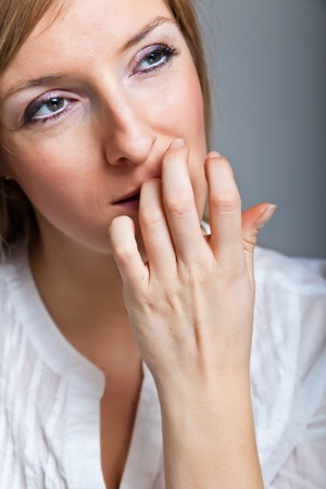 Depressed, sad woman on neutral background Stock Photo - 9122451