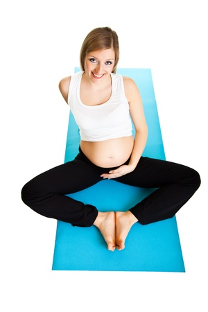 Pregnant woman fitness isolated on white