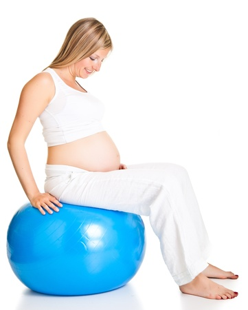 Pregnant woman excercises with gymnastic ball Stock Photo - 9566021