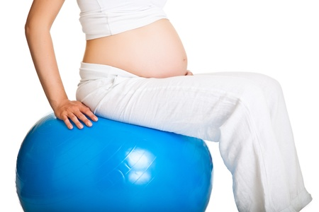 pregnant woman yoga: Pregnant woman excercises with gymnastic ball