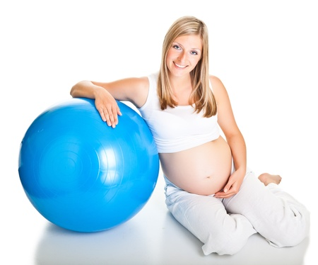 prenatal: Pregnant woman excercises with gymnastic ball