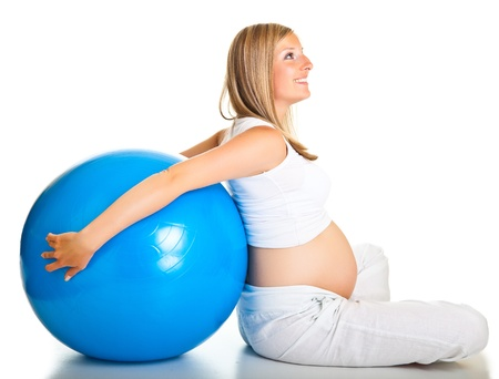 Pregnant woman excercises with gymnastic ball photo