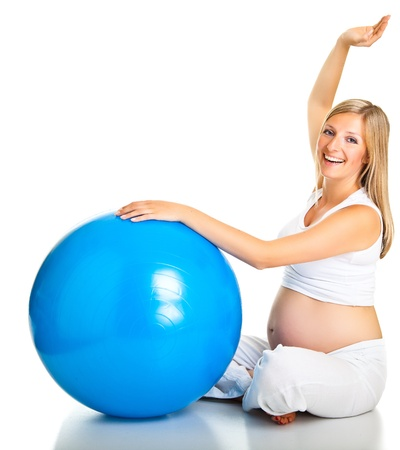 Pregnant woman excercises with gymnastic ball Stock Photo - 9566020