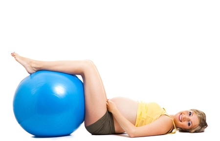 Pregnant woman with gymnastic ball isolated on white photo