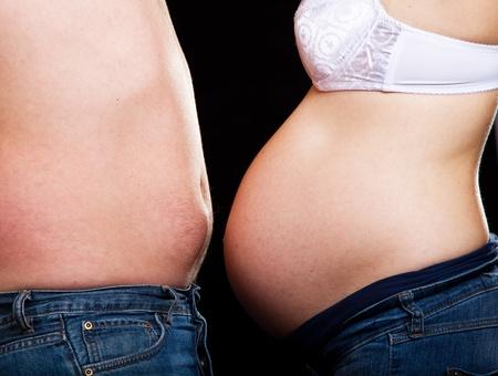 Pregnant couple on black background Stock Photo - 9657450