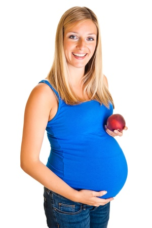 pregnant blonde: Pregnant woman with peach isolated on white